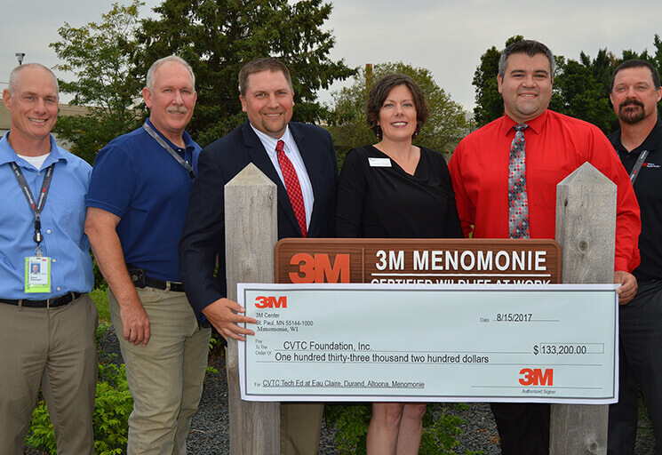 The presentation of a grant from 3M to CVTC involved, from left, Glenn Giesregen, 3M Menomonie plant engineering manager; Sean Mullan, 3M-human capital strategist lead; Jeff Sullivan, CVTC dean of skilled trades and engineering; Aliesha Crowe, executive director of CVTC Foundation, Inc.; Jason Lemay, principal of Altoona High School; and Tom Harris, 3M Menomonie plant manager.