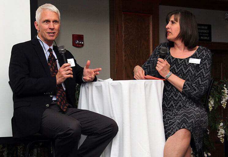 Dove Healthcare owner Tommy Davidson talks with emcee Barbara Cloutier on the stage at the Alumni Association Spring Gala Thursday, April 6. Dove Healthcare was honored with the 2017 CVTC Proven Business Partner Award at the annual event.