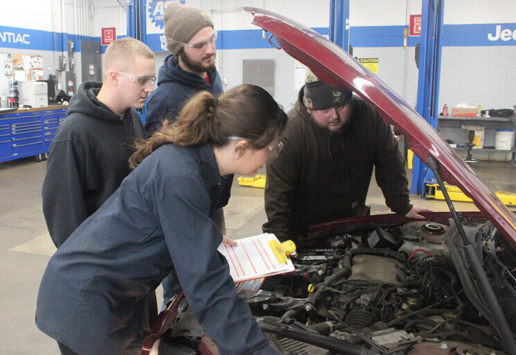 CVTC Auto Club members perform a free auto inspection for a customer at the club's Car Care Clinic Oct. 28. From left are Elysia Lunderville of Menomonie, Logan Horstman of Boyceville, Steven Lowe of Eau Claire, and club president Scott Adams of Eau Claire.