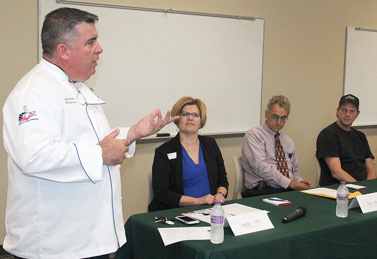 CVTC Culinary Management instructor Kevin Brown moderates a panel discussion on the needs of the local food industry and how the program can help. Panelists from left are Lynette Livingston, CVTC dean of business and academic services; Dave Challe, food and nutrition services director for Mayo Clinic Health Systems; and Nathan Berg, chef at The Lak