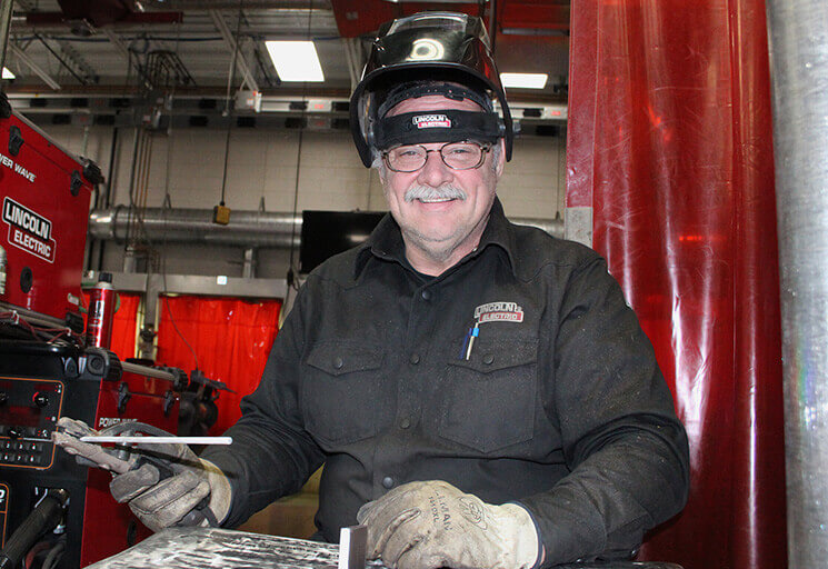 CVTC graduate Dave Scheidler prepares to weld during the last week of classes at CVTC Welding program lab.