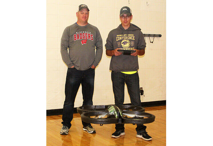 Durand High School student Jon Koller, right, controls a drone in the Altoona High School gym during Chippewa Valley Technical College's four-day Drone Camp. Looking on is Durand High School teacher Todd Poeschel.