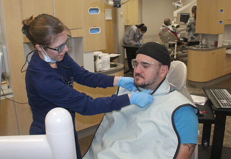CVTC Dental Hygienist program student Tina Rush of Bloomer prepares to take X-Rays of David Till of River Falls, the Pierce County Veterans Service Officer, at the Give Vets a Smile event at the Chippewa Valley Technical College Dental Clinic Saturday, Nov. 4. Approximately 75 veterans, who do not normally have dental care as part of veteran's bene