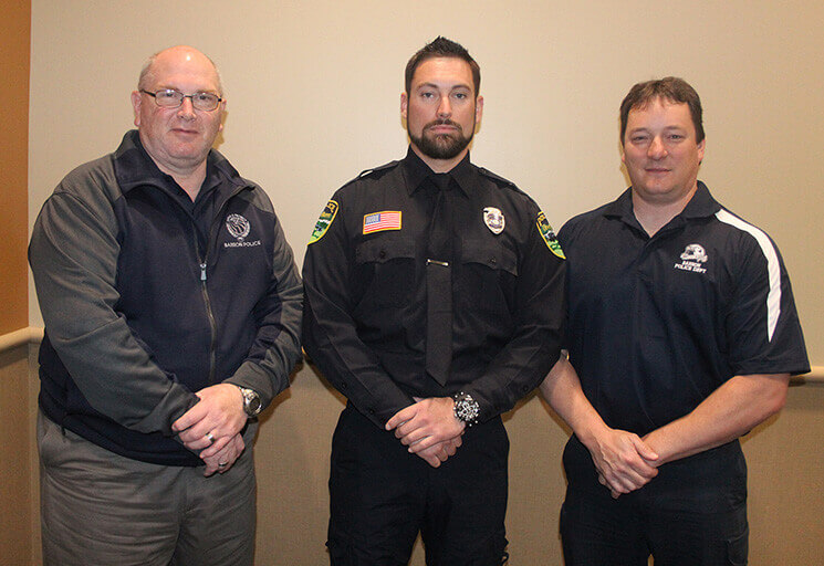 New Barron Police Department officer Eric Sowa, center, is joined by department Chief Byron Miller, left, and Assistant Chief Mike Freeman prior to the CVTC Law Enforcement Academy graduation May 20.