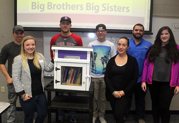 Emily Hardy, second from left, of Big Brothers Big Sisters accepted a Little Free Library from a group of CVTC students working on a project for their communications class last month. Students pictured, from left, are Cody Hobl, Chad Fox, Trent Iverson, McKayla Tape, Dave Hennessey and Bailey Ewald.