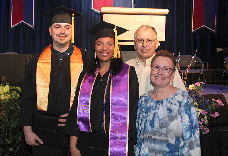 CVTC graduate Jennifer Georgeson is joined by her husband and fellow graduate, Garrett Georgeson, and the parents who adopted her at age 16, Robert and Kimberly Cropp of Durand, after the CVTC spring