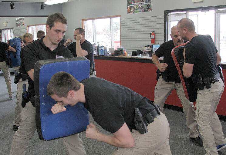 CVTC Law Enforcement Academy students practice active countermeasures during a 2016 Academy session.
