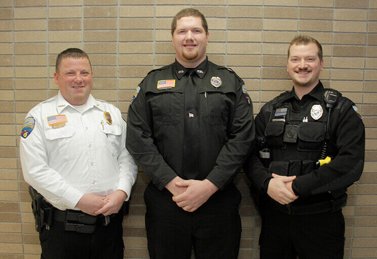 New Durand Police Officer Jared Baldwin, center, is joined by Durand Chief of Police Stan Ridgeway, left and officer Clynt Ebling prior to the CVTC Law Enforcement Academy graduation Dec. 20.