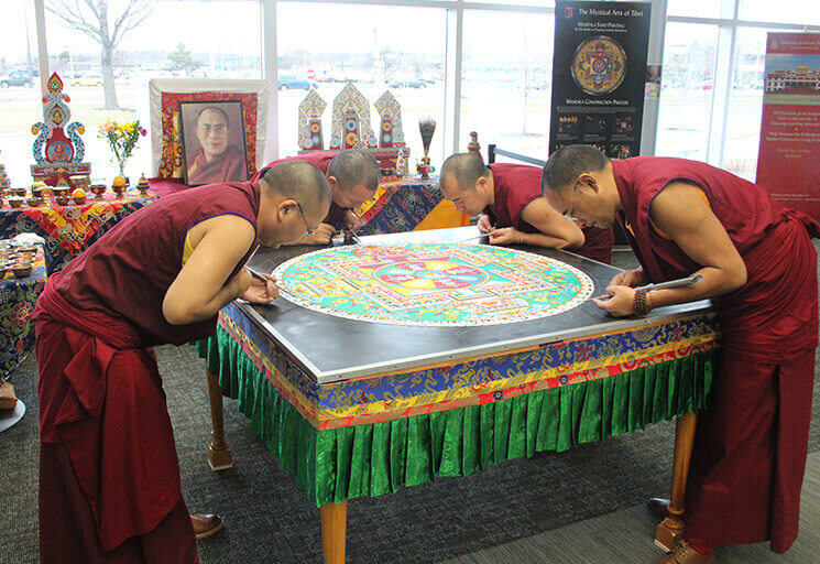 Buddhist monks from the Drepung Loseling Monastery work on a mandala sand painting at CVTC in Eau Claire in March 2016. The public is invited to come to CVTC and observe the monks creating a new mandala Oct. 1-4.