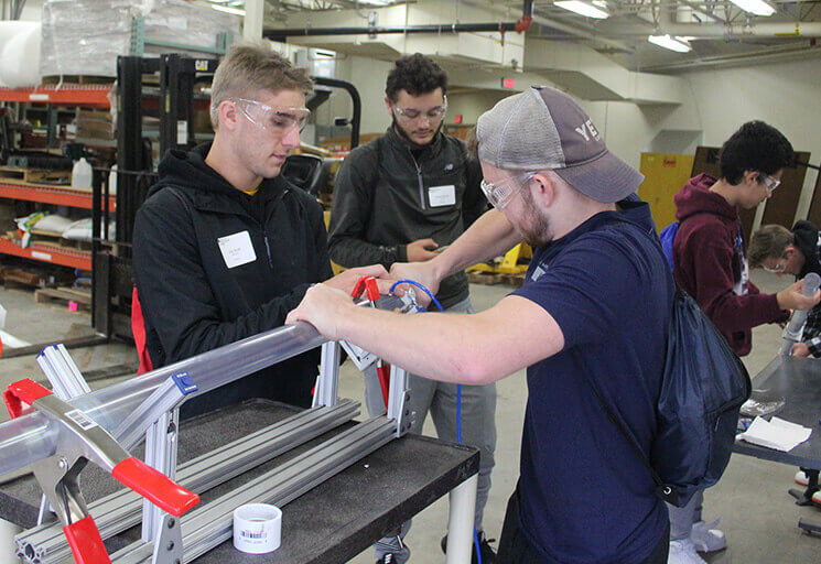 Altoona High School seniors Zac Kratt, left, and Blake Brown work on a device designed for them to use science and math skills to predict outcomes of materials testing during Manufacturing Day activities at CVTC Oct. 5. Altoona and Durand High School students took part in a pilot project on Industrial Mechanic skills at the annual event held at CVTC's Manufacturing Education Center.