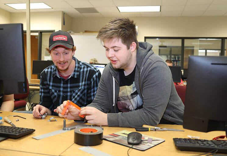 CVTC Mechanical Design students Trent Fransway of Chippewa Falls, left, and Noah Edlin of Boyceville work on a project together at the CVTC Manufacturing Education Center in Eau Claire last December.