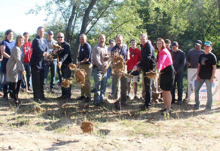 Dirt flies as representatives from Chippewa Valley Technical College and the Chippewa Valley Home Builders Association break ground for a new house in Eau Claire to be built by the CVTC students looking on. The finished house will be part of the CVHBA Parade of Homes in June 2019.