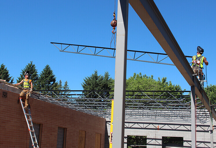 Workers from general contractor Market & Johnson prepare to attach a steel joist as work continues on a 7,200 sq.-ft. addition to the River Falls campus of Chippewa Valley Technical College. Work is scheduled to be completed by the start of the fall semester in August.