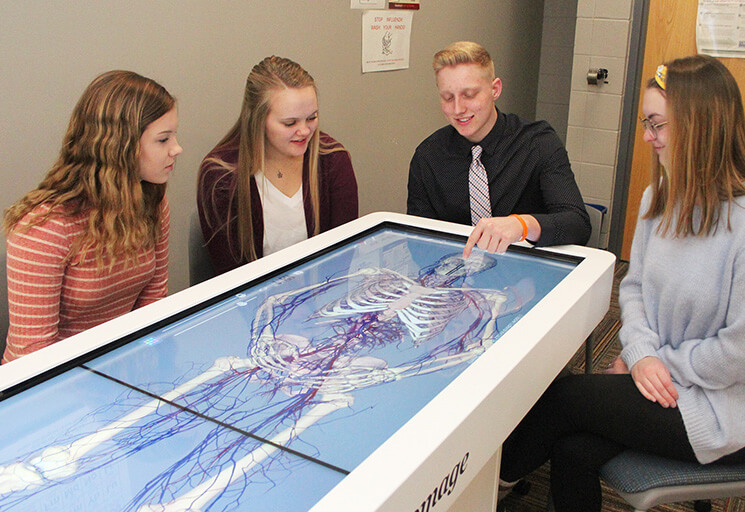 CVTC Healthcare Academy students examine an image on the Anatomage Table at the CVTC Chippewa Falls campus March 1. From left are Bryanna Bonander of Cornell, Lydia Culver of Bloomer, Taylor Anders of Fall Creek and Allie Bresina of Altoona.