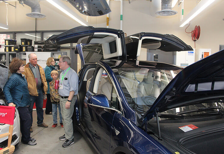 Randy Kruger of Marshfield, right, talks with Millie Lenseling of Menomonie and Ken Schmitt of Chippewa Falls and his son, Tim, about Kruger's Tesla X Model fully electric vehicle at the Experience Electric Vehicles event at CVTC's Energy Education Center Saturday, April 27.