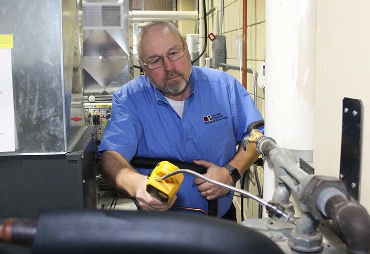 Instructor RC Jensen demonstrates testing for natural gas leaks in the CVTC Air Conditioning, Heating and Refrigeration lab. Jensen will teach students skills needed to construct and maintain natural gas lines in a new Gas Utility Construction & Service program starting in June 2019.