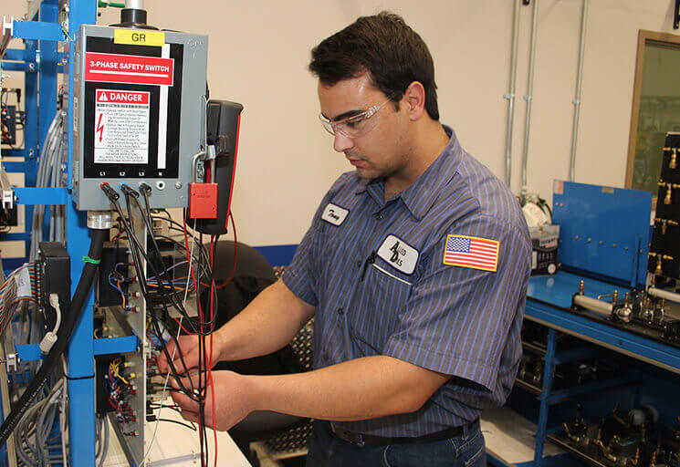 Tony Hess of Lake Hallie works on a timer relay circuit in the Industrial Mechanic lab at CVTC in December 2018. Hess also work at Allied Dies in Chippewa Falls, which is preparing him to be the in-house mechanic when he finishes school.
