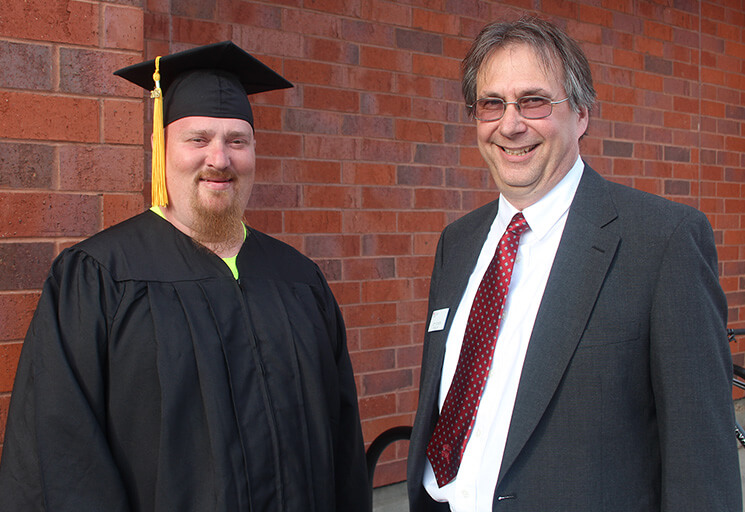 CVTC graduate Bob Juhnke of River Falls, left, accepted congratulations from Automation Engineering Technology Instructor Jim Koehn prior to the Spring Commencement in Eau Claire May 17. Last year, Juhnke was among the graduates at the River Falls campus, but he continued with CVTC completing an associate degree in the program.