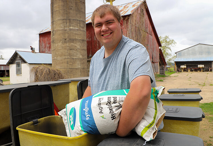 Blake Sam adds seed to a corn planter at Sam's Produce in rural Arkansaw. He plans on continuing with the family business after his graduation from CVTC's Agronomy Management program.