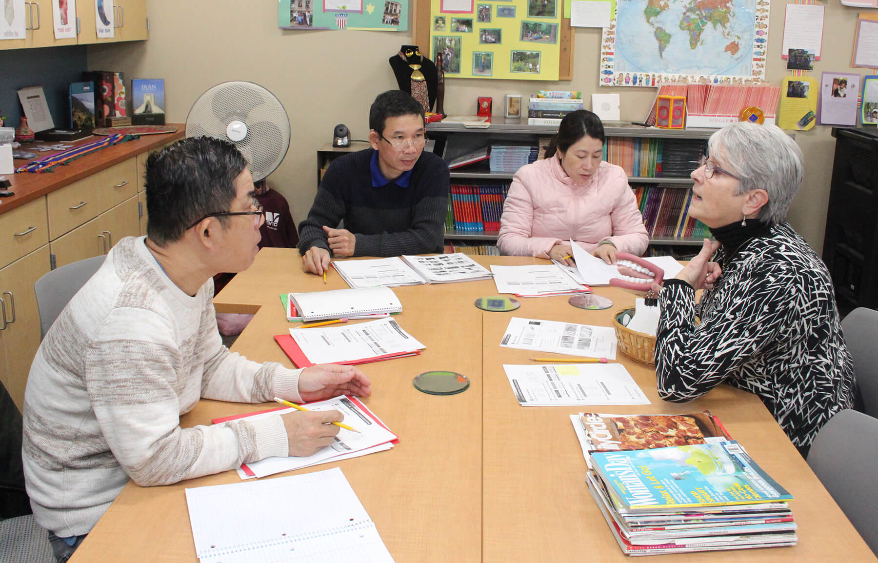 Juli Baker, right, works with students in the English Language Learner class at CVTC in this 2018 file photo. Many students who enter CVTC's ELL program first receive services from Literacy Chippewa Valley, which has a strong partnership with CVTC.
