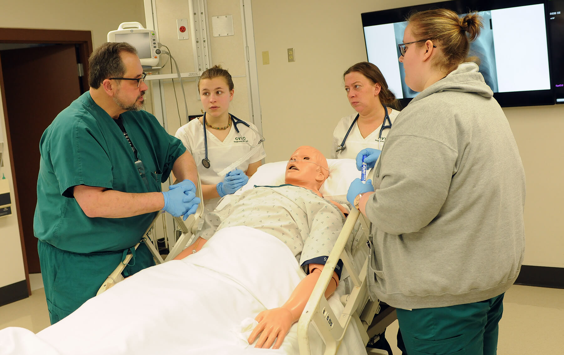 CVTC Respiratory Therapy Instructor Don Raymond, left, works with students in a medical simulation lab at CVTC in this 2018 file photo. Raymond, along with fellow instructor Theresa Meinen and several alumni, serve on the board of directors of the Wisconsin Society for Respiratory Therapy.