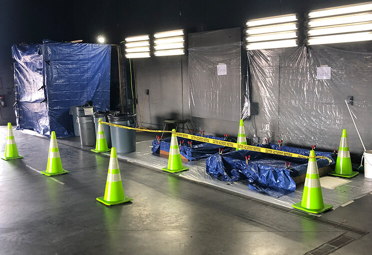 Space inside the burn room of the CVTC Fire Safety Center is set up as a decontamination location for emergency service vehicles during the COVID-19 pandemic.