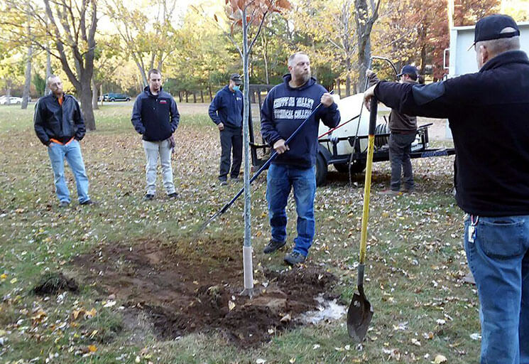 Led by instructor Matthew Staudenmaier, CVTC Landscape, Plant and Turf Management students observe and learn about the proper technics for planting trees during a service-leaning project at Mount Simon Park in Eau Claire when the group planted three trees in October.