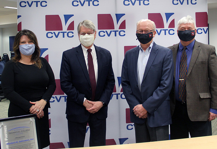 Posing after presentation of the Futuremaker Partner Award at CVTC are from left, CVTC Karen Kohler, executive director of institutional advancement; Bruce Barker, president of CVTC, and Market & Johnson representatives Dan Market, chairman and Jerry Shea, president.